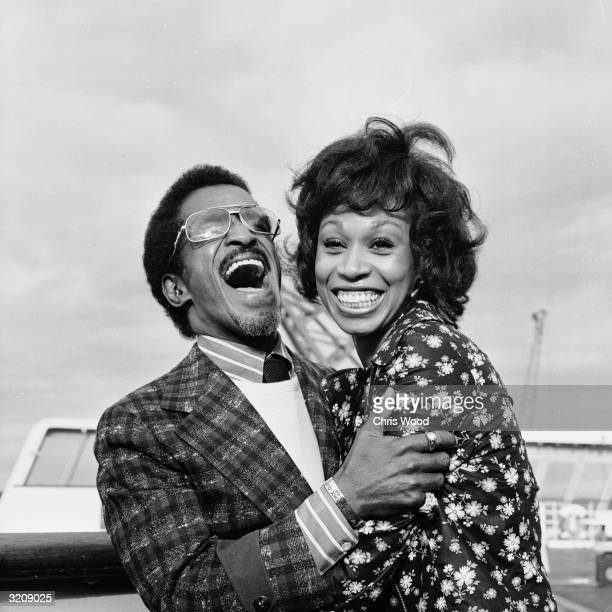Entertainer Sammy Davis Jr and his wife singer Altovise Gore arriving at Southampton on the QEII during their honeymoon