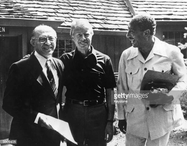 Israeli Prime Minister Menachem Begin Jimmy Carter the 39th President of the United States and Anwar Sadat President of Egypt The two Middle Eastern...
