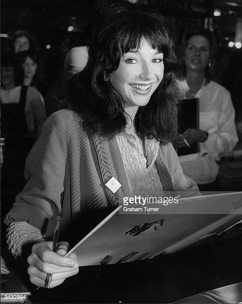 Singer Kate Bush signing copies of her latest album 'Never Forever' at the Virgin Mega Store, London.