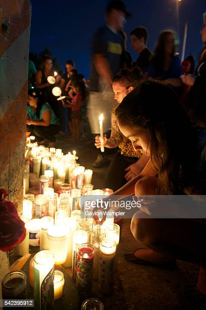 12ydearold Melia ReytherEspinoza lights candles at a Prayer vigil and memorial service for the victims and their loved ones Sunday across the street...