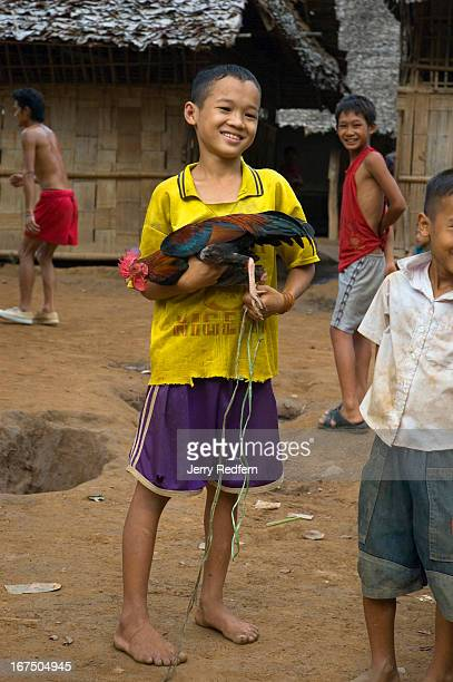 A 12yearold boy shows off his fighting cock on the school grounds at Mae Ra Ma Luang refugee camp He has been at the camp for 11 years More than 2000...