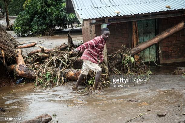 A 12yearold boy walks through the mud after River Muruny burst its bank following heavy rains in Parua village about 85 km northeast of Kitale in...