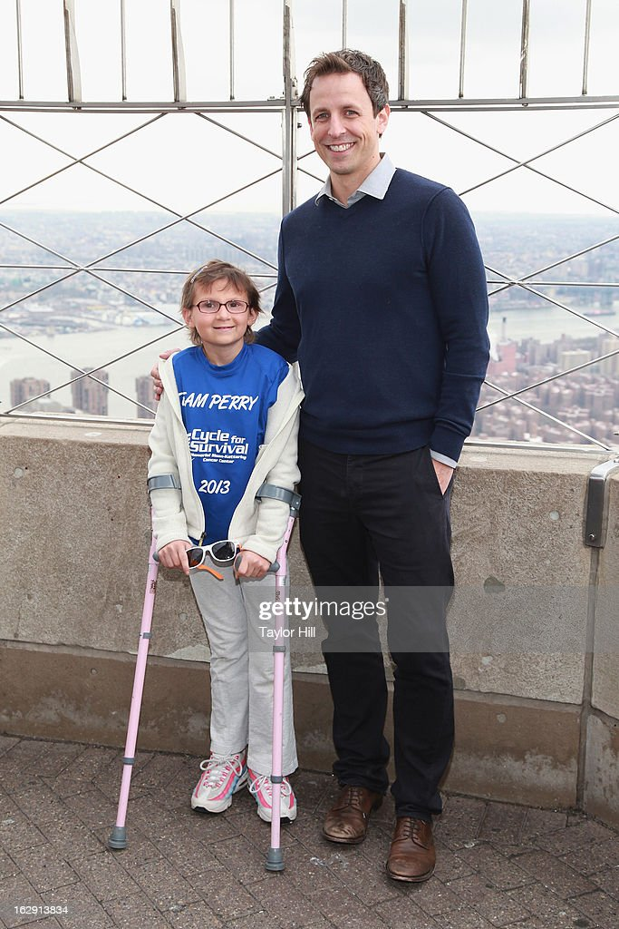 12-year-old cancer survivor Perry Zimmerman and actor Seth Meyers light The Empire State Building for Cycle for Survival on March 1, 2013 in New York City.