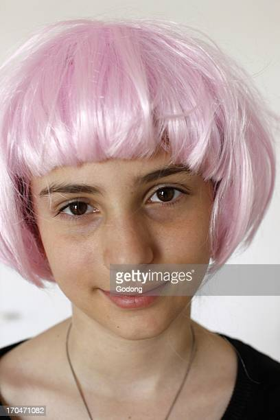 12yearold girl with a pink wig France