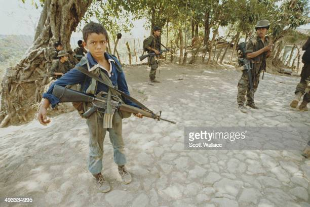 A 12yearold guerrilla of the FMLN with an M16 rifle in San Francisco Javier El Salvador during the Salvadoran Civil War 1989