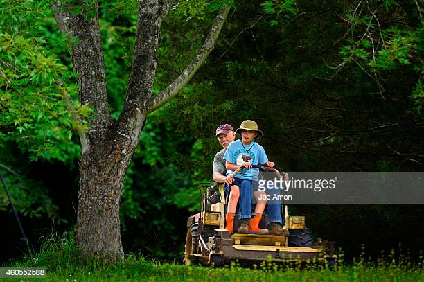 12yearold Preston Raynor is in all his glory with his grandfather Paw Paw Don Raynor for his last ride on the Grasshopper in North Carolina before...