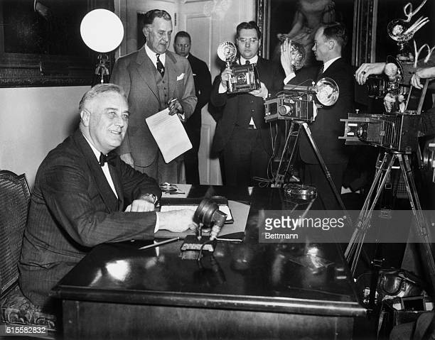 Washington, D.C.: President Franklin D. Roosevelt, hale and hearty as he celebrates his 56th birthday, is pictured broadcasting thanks to the people...