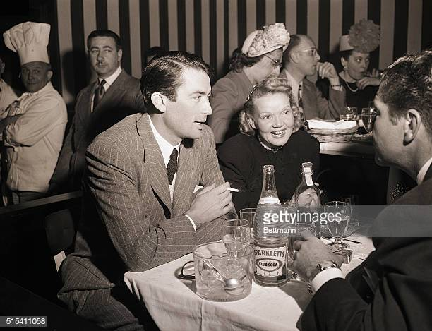 Hollywood, CA-: Leaving their two boys at home, Gregory Peck, and his wife Greta, join friends for an evening of fun at the opening of a new show at...