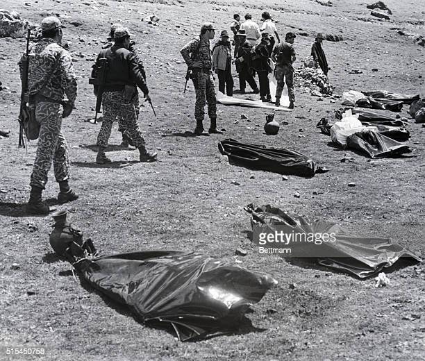 1/30/1983Ayachucho Peru Army soldiers check the bodies of eight Peruvian newsmen near Ayacucho 220 miles southeast of Lima The journalists were...