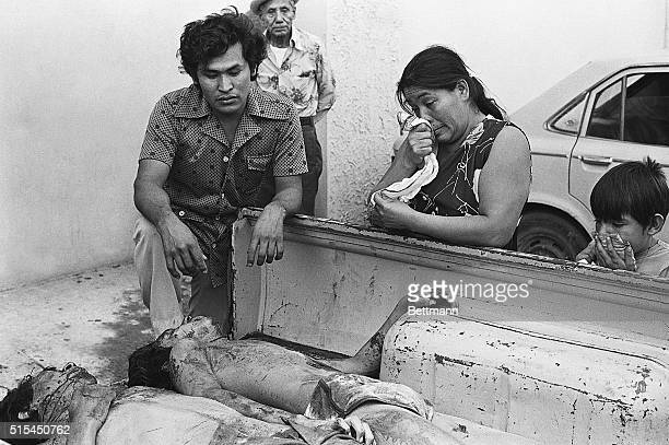 1/31/1982San Salvador El Salvador Family members weep after identifying relatives at a San Salvador morgue The victims were among 19 killed in a...