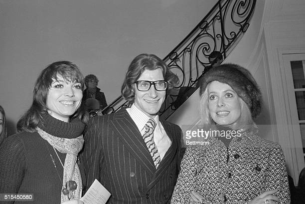1/31/70Paris France Fashion designer Yves Saint Laurent is flanked by two of the most prominent women attending his springsummer collection show here...