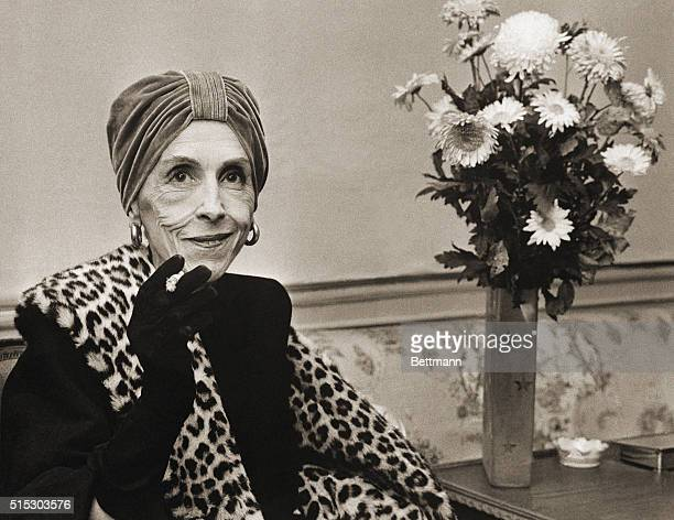 Copenhagen, Denmark- World-famed Danish authoress Countess Karen Blixen, better known under her pen nmae of Isak Dinesen, relaxes with a cigarette as...