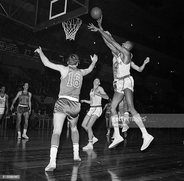 1/3/1961New York NY Sixfootfour George Lee of the Detroit Pistons is almost hidden by sevenfootone Wilt 'The Stilt' Chamberlain of the Philadelphia...