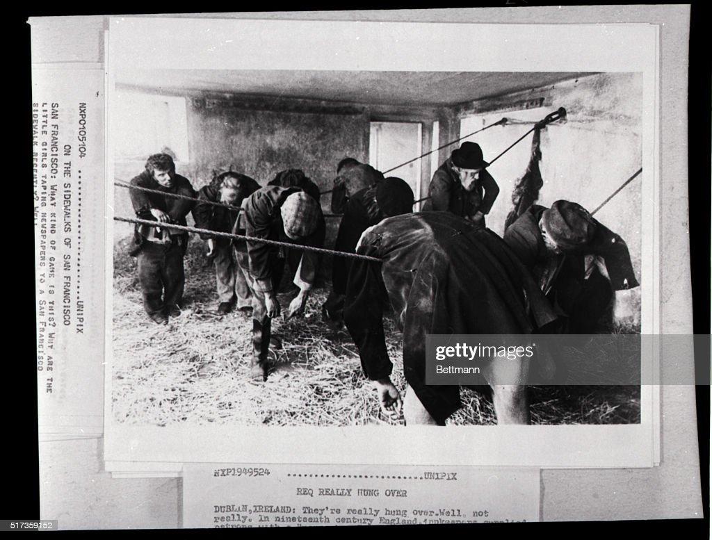 "Actors ""Sleeping"" Draped Over Ropes : News Photo"