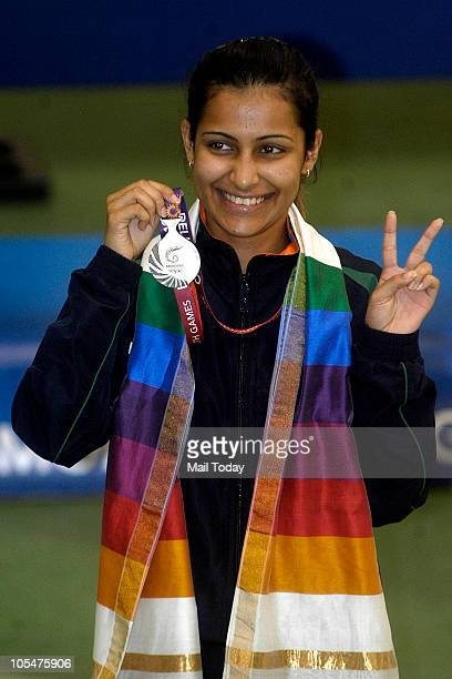 India's Heena Sidhu poses for pictures after winning silver in women's 10m air pistol singles shooting event of Commonwealth Games at Dr K Singh...