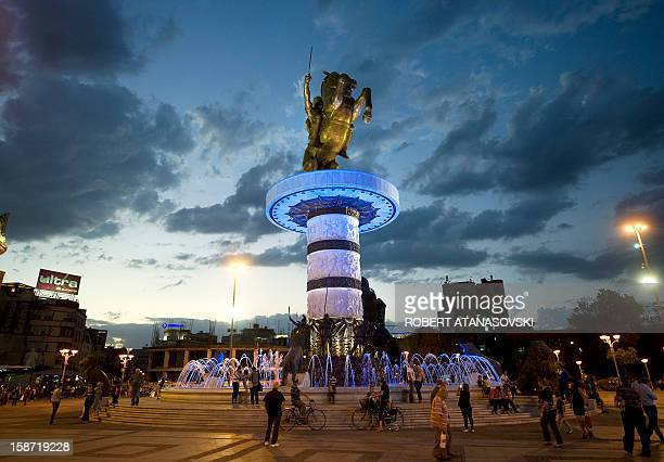 A 13meterhigh bronze statue of Alexander the Great officially named Warrior on a Horse onto its 10meter high pedestal is pictured at night in Central...