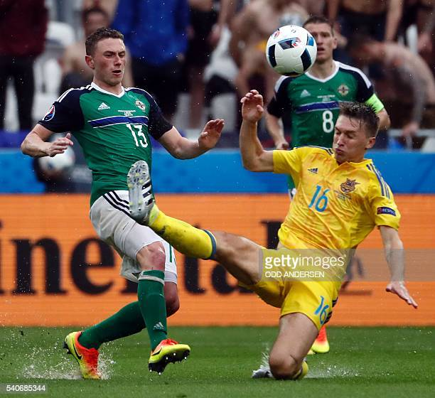 13Northern Ireland's midfielder Corry Evans vies with Ukraine's midfielder Serhiy Sydorchuk during the Euro 2016 group C football match between...