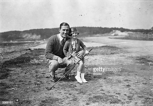 French boxer Georges Carpentier with his daughter Jacqueline at Le Touquet for a game of golf