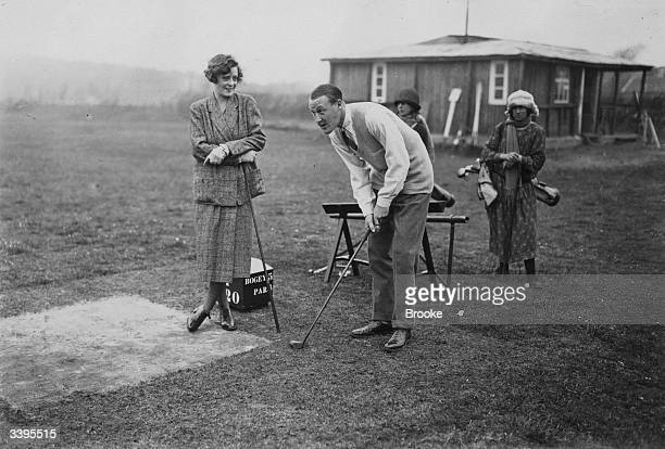 Mr and Mrs R H Tattershall play golf at the fashionable French resort of Le Touquet