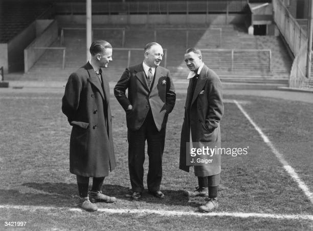 Arsenal Football Club Manager Herbert Chapman chats with a key member of his team Alex James on the pitch at Wembley before the FA Cup final