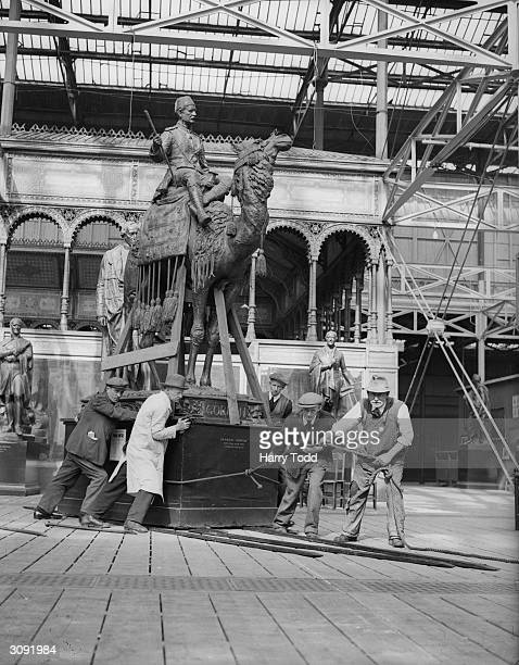 A replica statue of British colonial administrator General Gordon is replaced in the South transept of the Crystal Palace London after an exhibition