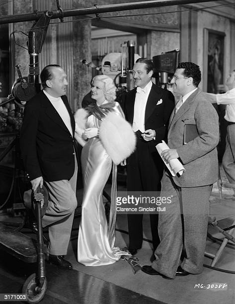 'Blonde Bombshell' Jean Harlow chats to British film director Edmund Goulding who is visiting the set of the MGM film 'Dinner at Eight' Actor Edmund...