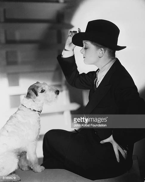 Myrna Loy stars as amateur sleuth Nora Charles in 'The Thin Man' directed by W S Van Dyke Asta the dog looks on in bemusement as his mistress dresses...