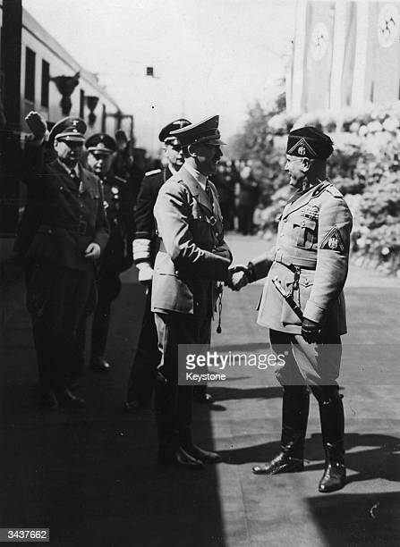 Italian fascist leader Benito Mussolini greeting Adolf Hitler upon his arrival in Florence