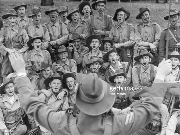 Militiamen of the 59th Battalion Hume Regiment singing the Australian folk song 'Where the Dog Sat on the Tucker Box'