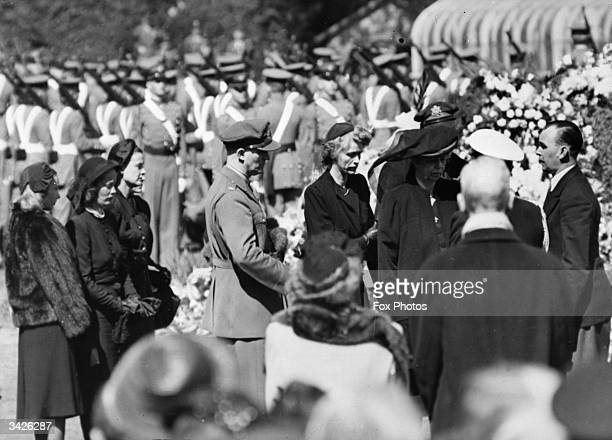 Mourners at the burial service of the former President of the United States Franklin Delano Roosevelt in Washington DC Left to right the wives of the...