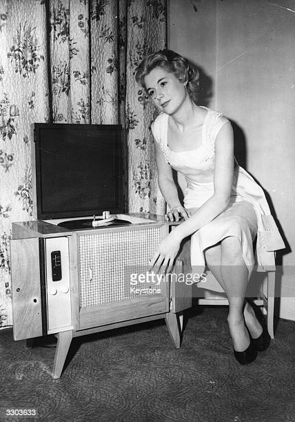 Iris Goodman of Penge listens to the new SuperPhonic Westcott Reproducer radiogram exhibited at the Radio Show held at the Washington Hotel London It...