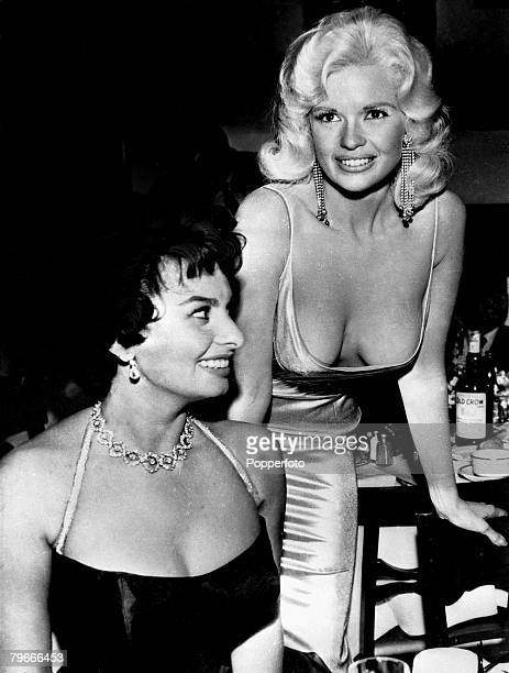 13th April 1957 USA American actress Jayne Mansfield and Sophia Loren seen together at a party in Hollywood held in honour of Sophia who was making...