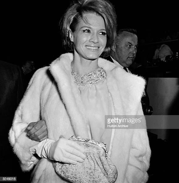American actor Angie Dickinson wearing a fur coat arrives at the Academy Awards Santa Monica California