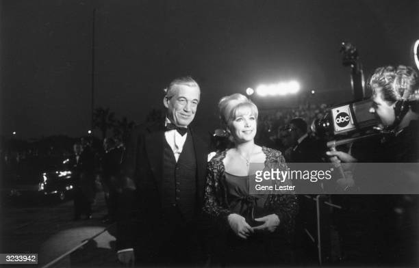 EXCLUSIVE American actor and film director John Huston smiles with American actor Stella Stevens as a television cameraman films them arriving at the...