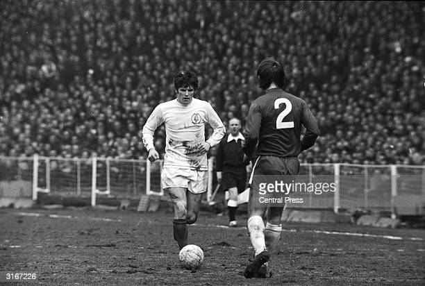 Dave Webb of Chelsea FC is forced to back off as Eddie Gray the left winger for Leeds FC runs at him with the ball during the FA Cup final The final...