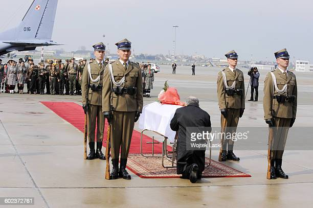 Leader of the Polish 'Law and Justice' political party Jaroslaw Kaczynski kneels in front of the coffin of Polish First Lady Maria Kaczynska at...