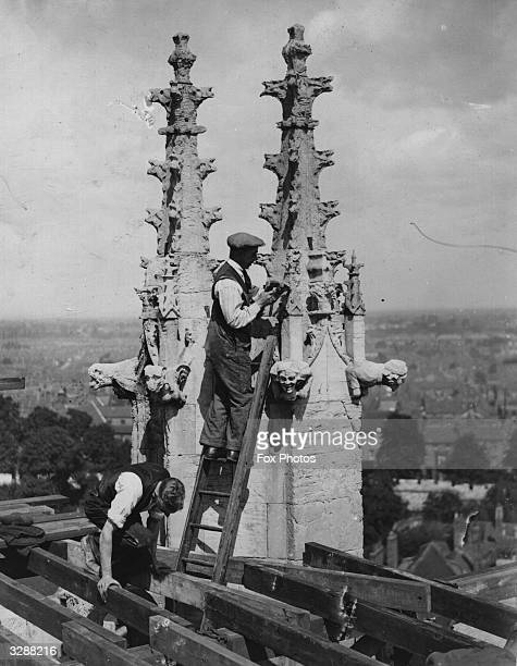 Craftsmen restoring the pinnacles on the roof of York Minster