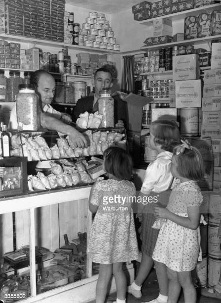 Children buying sweets at a shop in New Eltham London on the last day before they go back on the ration