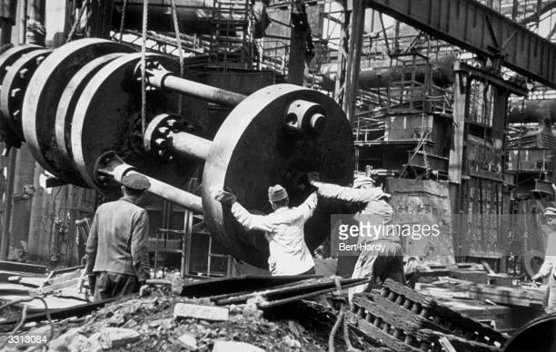 Workers dismantling the arms plant at the Krupp factory in Essen Original Publication Picture Post 4854 Two Germanys A Warning pub 1949