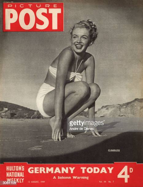 Young actress Marilyn Monroe crouches on a beach on a sunny day The headline beneath reads 'Germany Today A Solemn Warning' Original Publication...