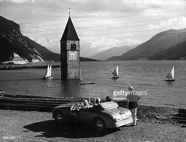 The Reschen Lake in southern Tyrol Italy which covers the sunken village of Graun Only the church steeple still shows above the water of the lake...
