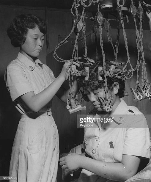 A perm machine at the beauty parlour belonging to the Korean Army's Women Auxiliaries