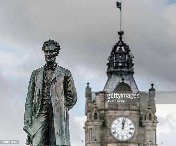 13th August 2014 Statue of Abraham Lincoln in Edinburgh's Old Calton Burial Ground The Balmoral Hotel clock tower is in the background