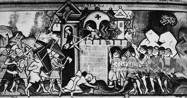 A 13th Century siege in progress circa 1250 The attackers are assaulting the walls under large shields and using burning straw trusses while the...