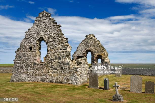 13th century st mary chapel ruins of fieldstone on church grounds with cemetery gravestones at old rattray aberdeenshire scotland uk - rattray head stock pictures, royalty-free photos & images