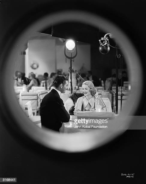 Clark Gable and Constance Bennett on the set of 'After Office Hours' directed by Robert Z Leonard