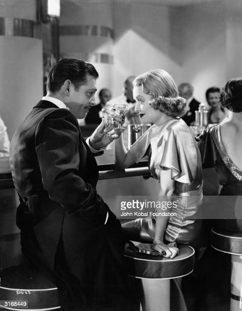 Clark Gable and Constance Bennett raise their glasses in 'After Office Hours' directed by Robert Z Leonard