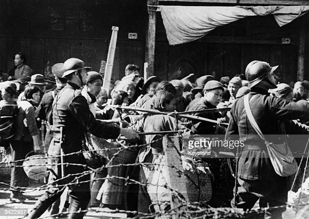 Chinese refugees fighting to enter the French concession prior to the Japanese taking Shanghai