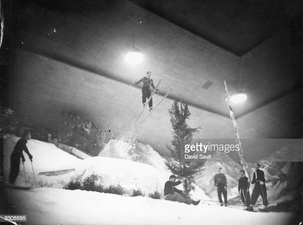 Sverre Kolterud Norwegian Olympic Skiing champion leaping over a 10 foot christmas tree at Earls Court