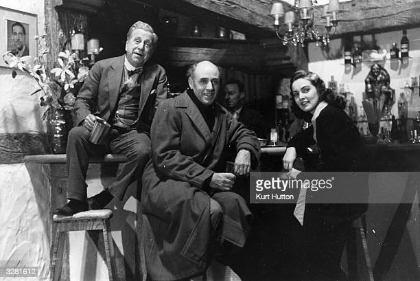 Alastair Sim Edward Rigby and Patricia Roc watch the other actors rehearse a scene for the film 'Let The People Sing' Title Let The People Sing...